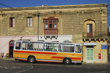 Characteristic colored bus typical of Malta