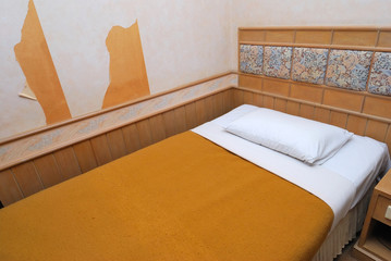 Single bed in modern hotel room