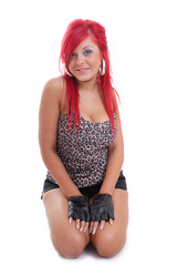 Cute young red head kneeling
