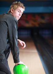 Portrait of young man prepared on bowling lane