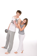 Fitness - Smiling healthy couple exercising with weights