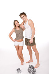 Fitness - Young healthy couple with weights