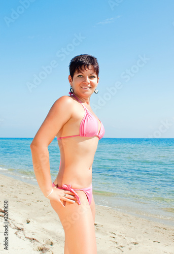 young  girl in bikini on beach