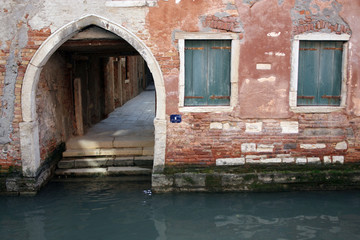 Ancient archway above backwater of Venice