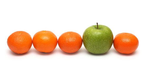 different concepts with mandarins and apple