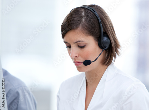 Portrait of a brunette customer agent at work