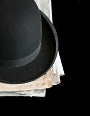 Black Bowler hat on newspapers