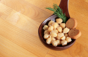 Chickpeas in a wooden spoon