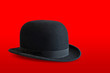 Bowler hat on red background