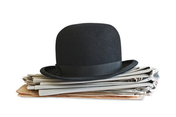 Bowler hat on newspapers