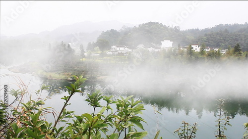 beautiful old village in China, timelapse of fog crossing over