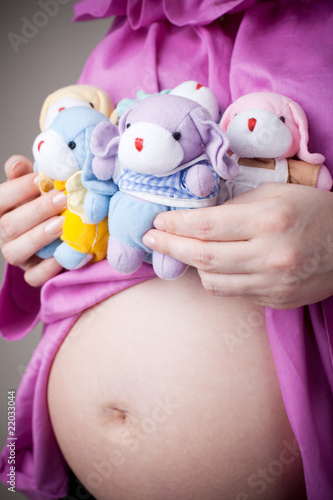 teddy bears sitting on pregnant belly