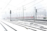 train in Wintertime on track in snow flurry poster