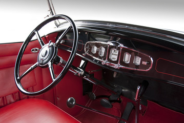 Dashboard and steering wheel from classic 1940ies sedan