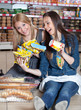two woman smiling on floor supermarket
