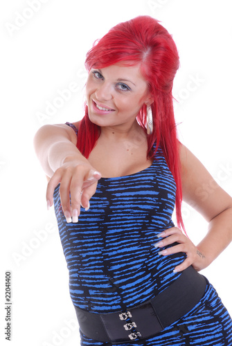 Smiling red haired girl pointing