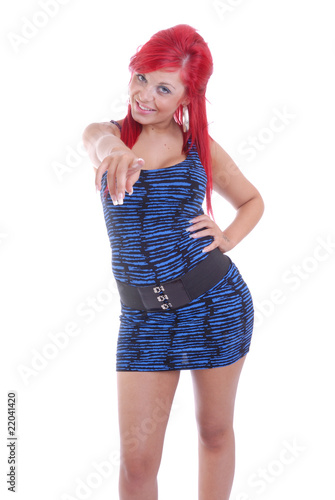 Happy red haired girl pointing