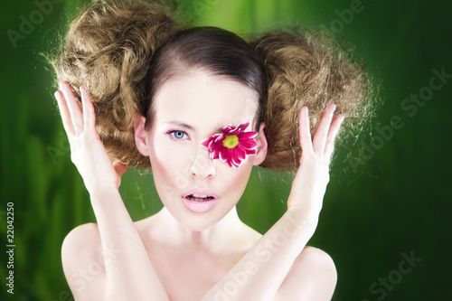Woman with flower on eye