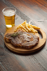 grilled porterhouse with french fry and beer