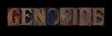 the word genocide in old wood type