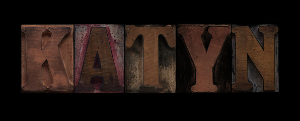 the word Katyn in old wood type