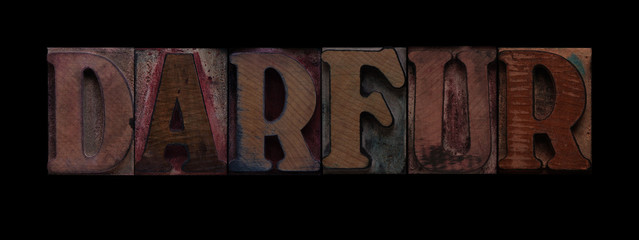 the word Darfur in old wood type