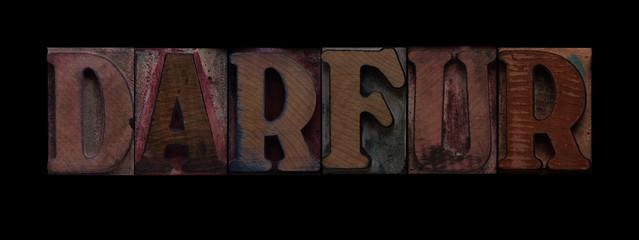 the word Darfur in old wood type