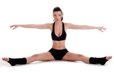 Woman doing gymastic exercise on floor