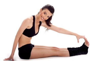 Woman stretches her leg before and exercising