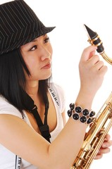 Chinese girl fixing the saxophone.