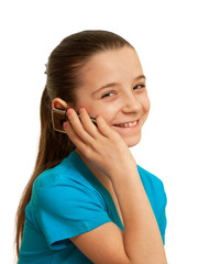 Smiling girl speaking on the mobile phone