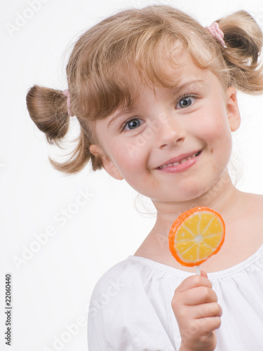Cute girl with lollipop