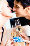 Kissing couple on romantic date or celebrating at restaurant poster