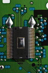 Microchip on green printed circuit board