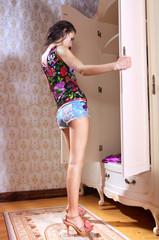 girl has opened wardrobe