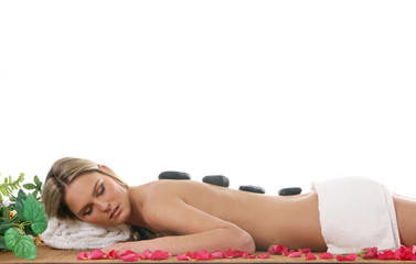 A young woman is getting spa treatment. Image isolated on white