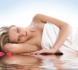 A young woman covered with a towel is getting spa treatment