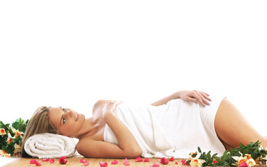 A young woman getting spa treatment. Image isolated on white