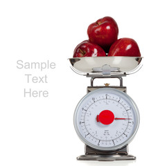 Fruit on a scale with a white background and copy space