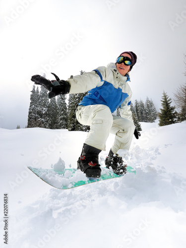 Snowboarder Girl riding down hill