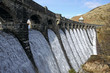 Craig Goch dam overflowing with water, Elan Valley Wales.