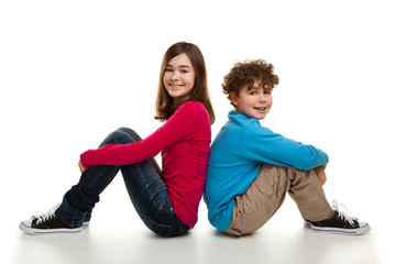 Girl and boy sitting