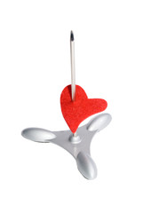 Red heart on a paper spike (isolated on white)
