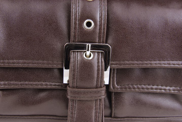 brown leather bag buckle