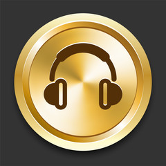 Headphones on Golden Internet Button