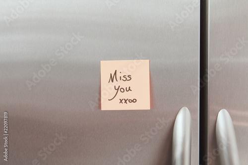 Sticky Note on a Refrigerator