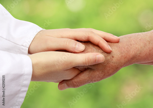 Nurse helping senior in nature