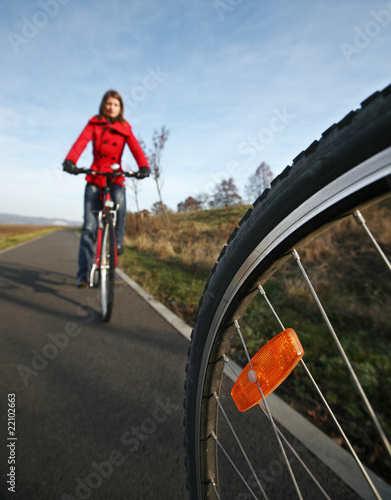 Biking (the image is motion blurred to convey movement; focus is