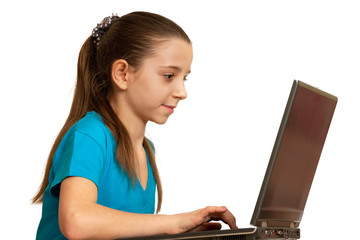 Smiling girl studying with the laptop