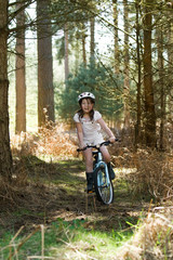 Young Girl Riding her Bike in the Forest